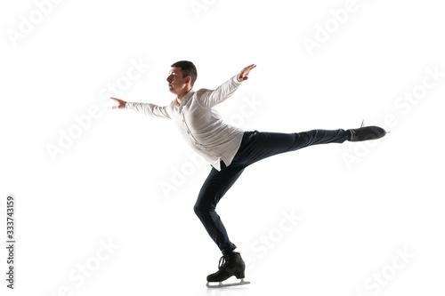 Fototapeta premium Człowiek w Łyżwiarstwie Figurowym samodzielnie na białym tle studio z copyspace. Profesjonalne ćwiczenia i trening w akcji i ruchu na lodzie. Pełen wdzięku i nieważkości. Pojęcie ruchu, sportu, piękna.