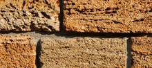 Brick Wall Of Yellow Shell Roc...
