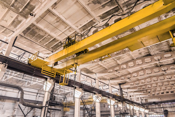 Overhead crane at an industrial plant, background production, construction site