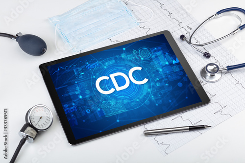 Photo Close-up view of a tablet pc with CDC abbreviation, medical concept