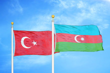 Turkey And Azerbaijan Two Flags On Flagpoles And Blue Cloudy Sky