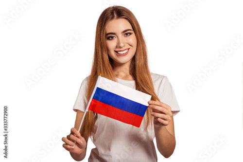 Photo A beautiful young woman holds in her hands the flag of Russian Federation