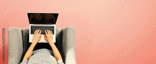 Woman using a laptop computer overhead view Wallpaper Mural