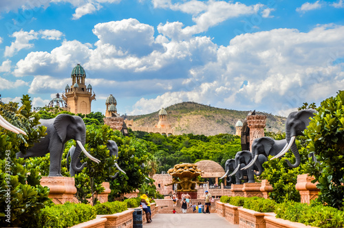 Fototapeta Entrance of The Palace / Lost City /Sun City with stone statues under blue and cloudy sky obraz