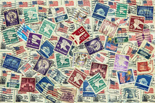 Set Of Various USA Postage Stamps As Background.