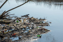 Dam Of Sticks And Debris Floating On The River, Environmental Pollution, Water Landscape, Sunny Day.