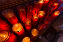 Red Prayer Candles Lit In Rows...