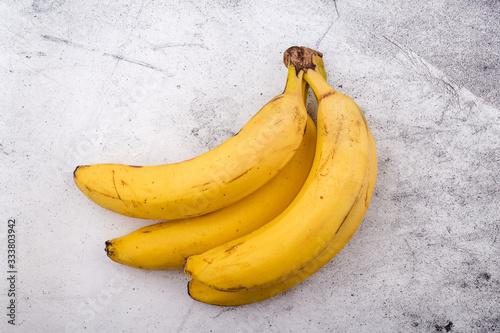 Fresh bananas on grey background Tapéta, Fotótapéta