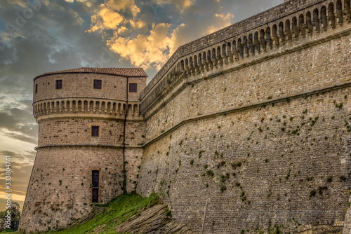 San Leo prison fortress medieval machicolation of a cannon tower supporting corbels of the battlement in Italy