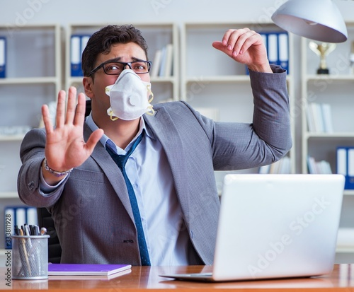 Businessman sweating excessively smelling bad in office at workp Wallpaper Mural