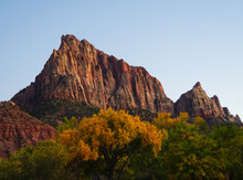 The Last Rays Of The Autumn Sun Illuminate A Beautiful Red Rock Mountain In Zion National Park.