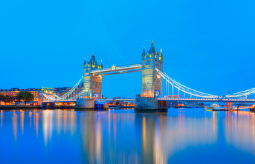 Panorama of the Tower Bridge and Tower of London on Thames river at twilight blue hour - London England