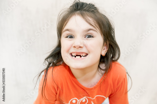 defocused funny close up face portrait of Little agressive naughty girl with ang Canvas-taulu