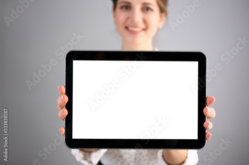 Fotografía Female hand holds black frame tablet pad on gray background setting while sitting on couch engaged an internet surfing using application mail tracking food delivery display leisure concept closeup