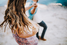 Beautiful Young Couple Walking Together At The Beach, Blurred Photo