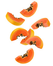 Falling Papaya Slice Isolated On White Background, Clipping Path, Full Depth Of Field
