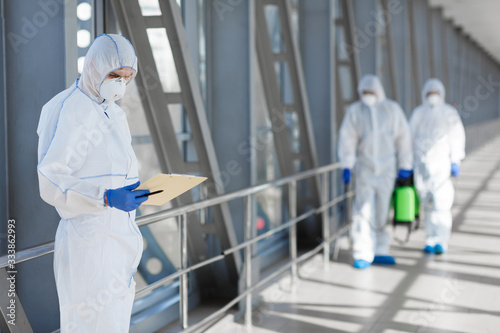 Head of the coronavirus protection team allocates places for disinfection Wallpaper Mural