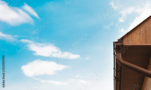 Fotografie, Tablou Modern roof gutter and drain pipe with copy space and blue sky for store banner or the production plant