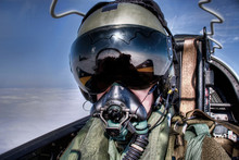 Royal Air Force ( RAF UK ) Pilot In The Cockpit Flying In An Ejector Seat Wearing Helmet, Visor And Oxygen Mask.