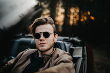 Young Male Driver In Sunglasse...
