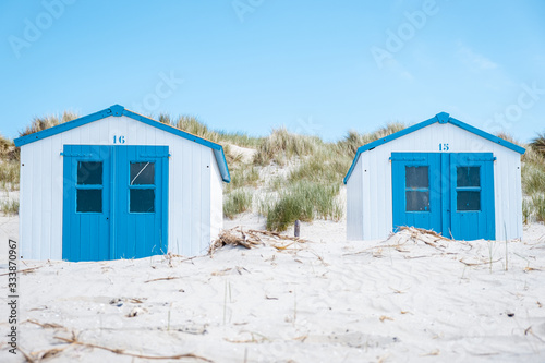 Texel Island Netherlands, blue white beach hut on the beach with on the backgrou Tableau sur Toile