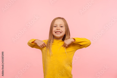 Fotografie, Obraz This is me! Pretty cute cheerful little girl pointing herself, sincerely smiling to camera, boasting, rejoicing winning, child happy and proud of achievement