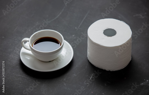 Fototapeta Cup of coffee and toilet paper obraz