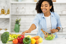 Happy Young Afro Girl Preparing Vegetable Salad