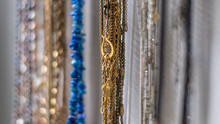 Isolated Close Up Of A Hand Made Chain Jewelry Rack Filled With A Wide Variety Of Colorful Jewels- Israel