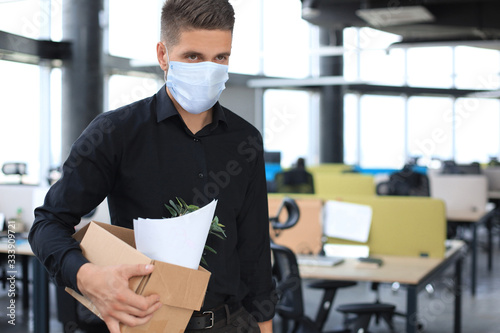 Tablou Canvas Dismissal employee in an epidemic coronavirus