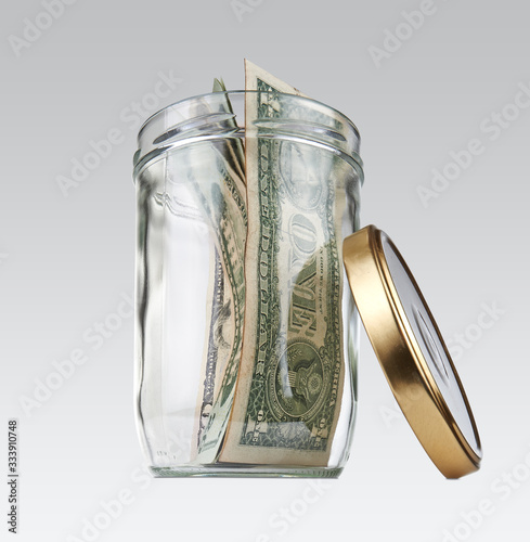 Glass jar with some us bill. Concept for the no cash in store Canvas Print