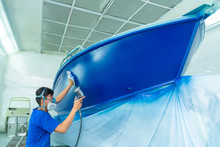 Repairman Fixing By Painting Boat Body And Painting Boat Using Spray Gun