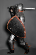 A Medieval Knight In Armor Wit...