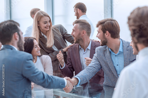 Fototapety, obrazy: handshake business partners during a meeting in the office