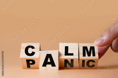 Hand flipping wooden cubes for change wording Panic   to  Calm Canvas Print