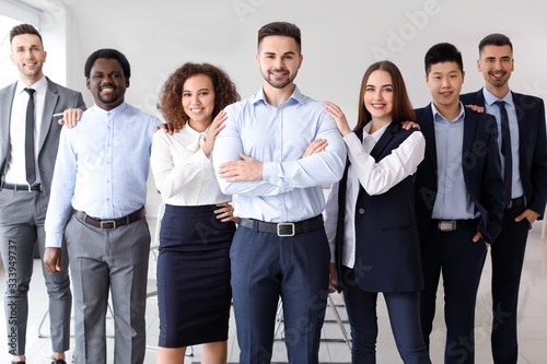 Fototapety, obrazy: Group of business people in office. Unity concept