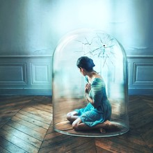 Woman Sitting In Glass Cage