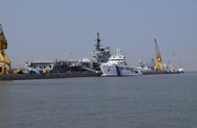 Indian Viraat Aircraft Carrier And Coast Guard Ship Anchored At A Port In Mumbai
