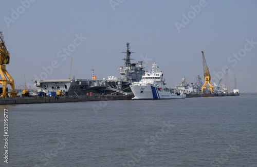 Fényképezés Indian Viraat aircraft carrier and Coast Guard ship anchored at a port in Mumbai