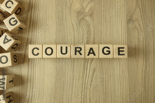 Word courage from wooden blocks Fototapete