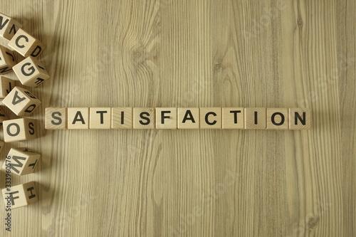 Word satisfaction from wooden blocks Wallpaper Mural
