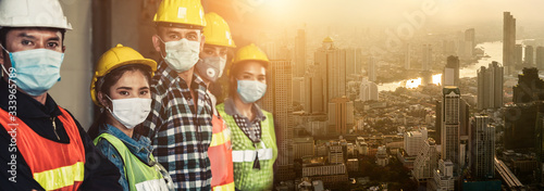 Fototapeta Factory workers with face mask protect from outbreak of Corona Virus Disease 2019 or COVID-19. obraz
