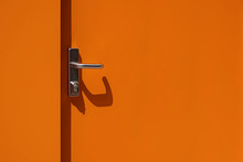 Bright Orange Metal Door With ...