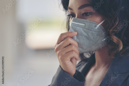 Obraz Covid-19 patient coughing and wearing a medical mask to protect from the coronavirus and bacteria While being outdoors and in community. Covid-19 Virus Protection concept - fototapety do salonu