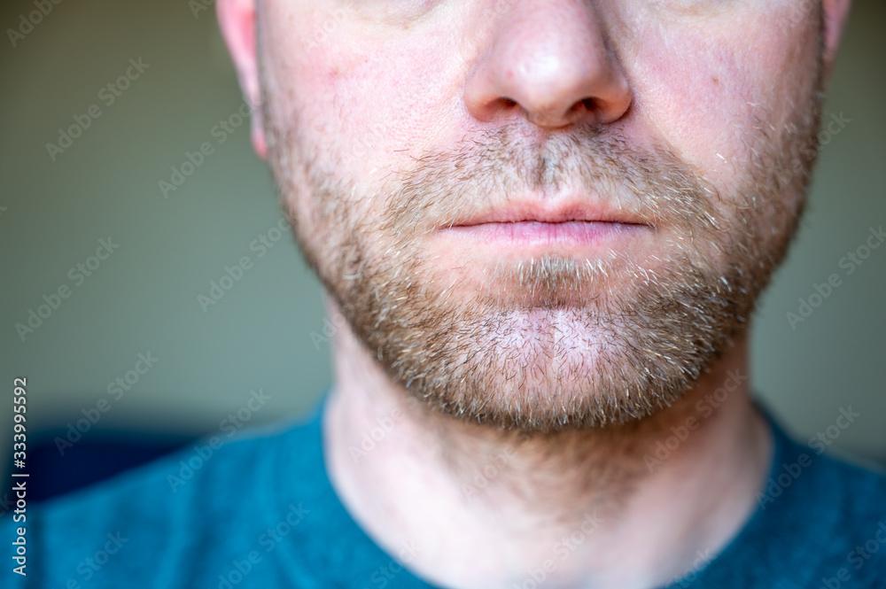 Fototapeta Chin, nose, and lips of unshaven white male