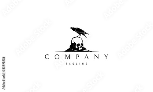 Fototapeta Vector logo on which an abstract image of a raven sitting on a skull