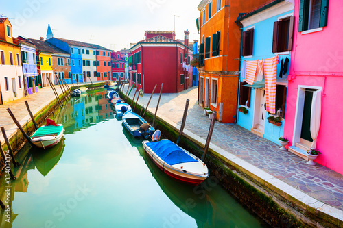 Fototapeta Colorful houses on the canal in Burano island, Venice, Italy. Famous travel destination obraz