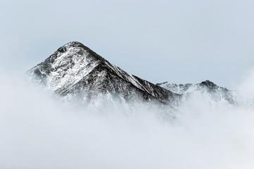 Obraz na Szkle Krajobraz landscape of snow mountain peak in fog