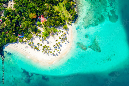 Valokuvatapetti Aerial drone view of beautiful caribbean tropical island Cayo Levantado beach with palms