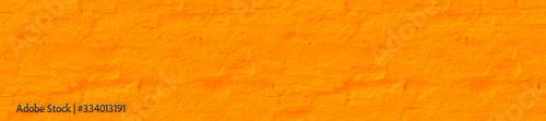 Panorama saffron plastered brick wall texture.